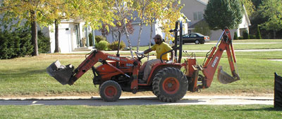 heavy machinery driving over protected grass